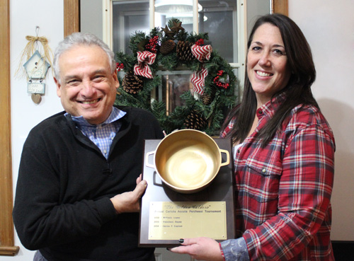 Last year's winner, Chuck, passing the Golden Caldero to our 2015 Parcheesi Tournament winner, Joyce.